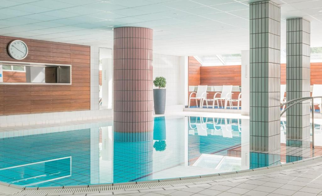 The swimming pool at or near Hôtel Diana Restaurant & Spa by HappyCulture
