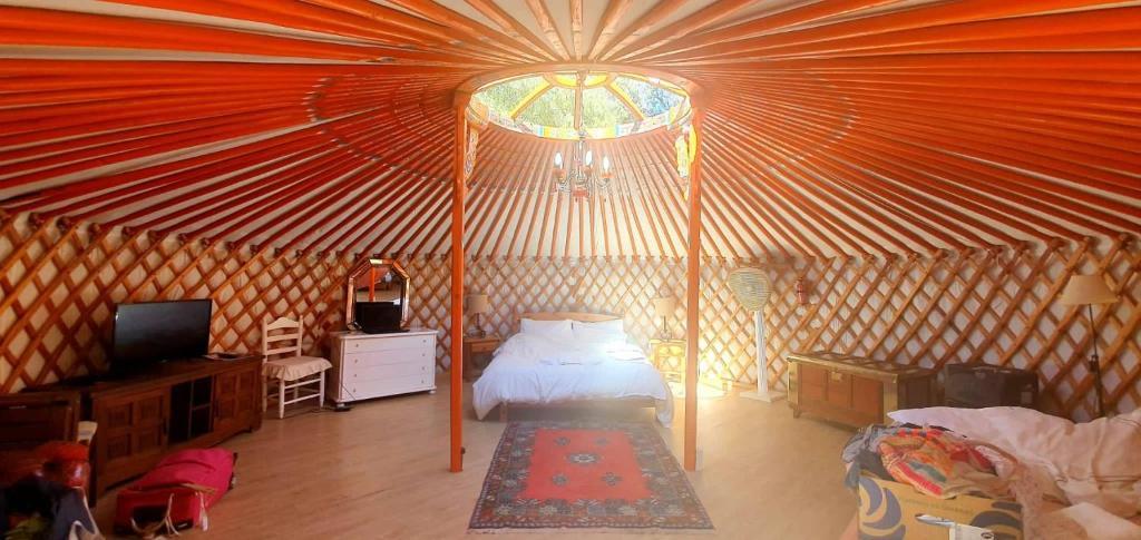 Cama o camas de una habitación en Eldorado Yurt