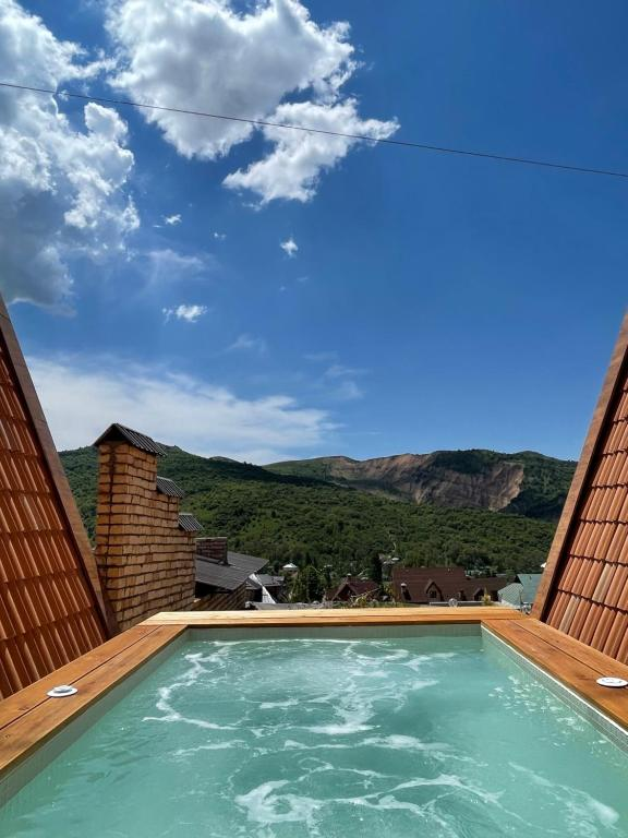 The swimming pool at or close to Premium Villas with panoramic view to Chimgan