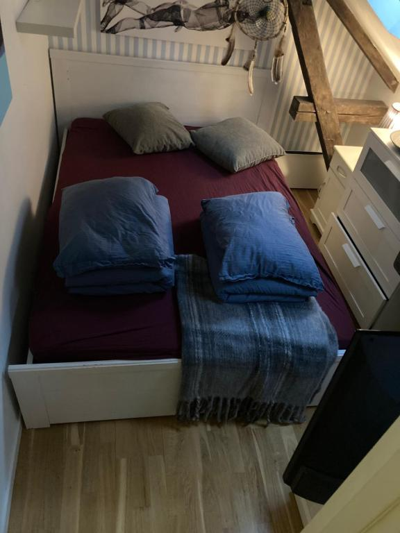 A bed or beds in a room at Ålesund downtown loft room with shared bathroom