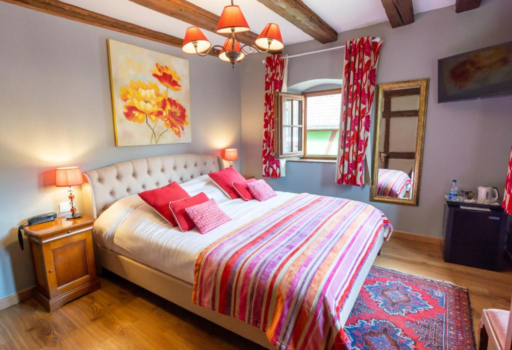Un ou plusieurs lits dans un hébergement de l'établissement Hotel à l'Oriel