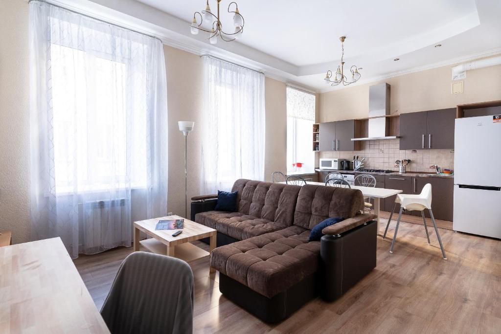 Гостиная зона в NaSutkiPro Apartments on Nevsky Prospekt