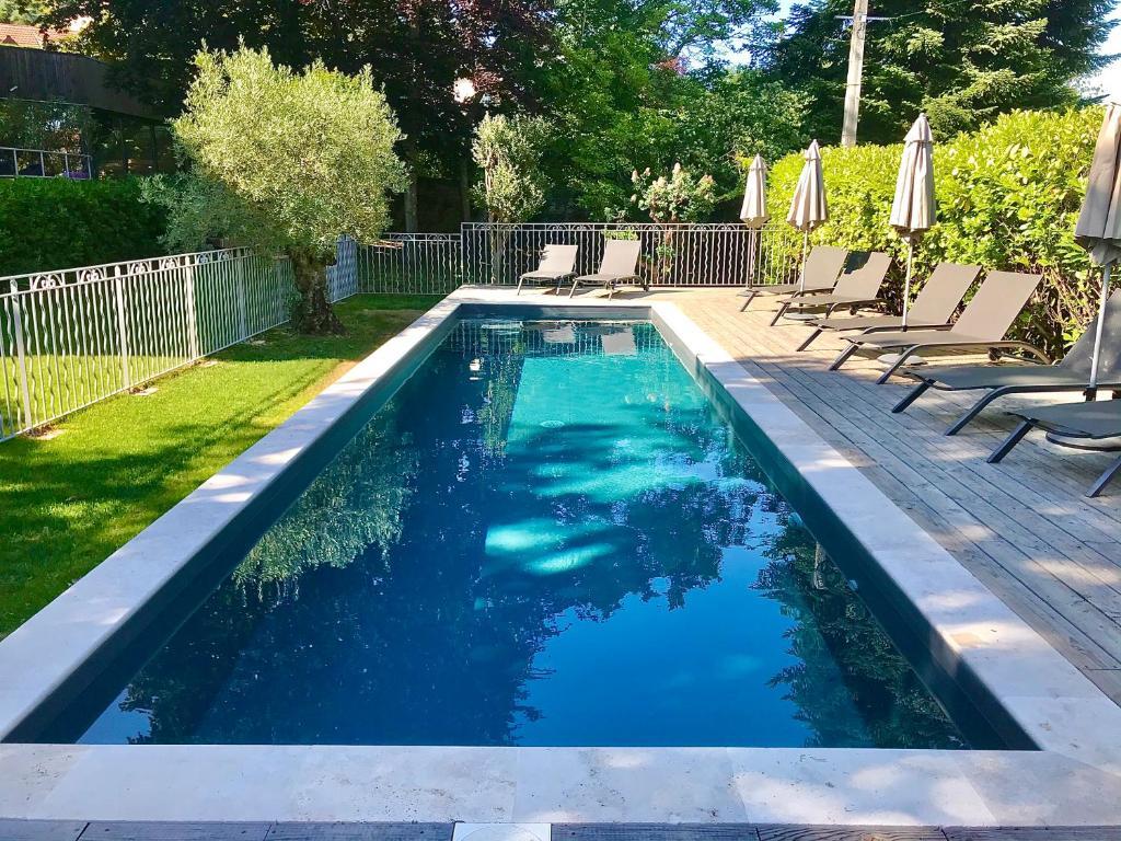 The swimming pool at or near Villa Elisa M