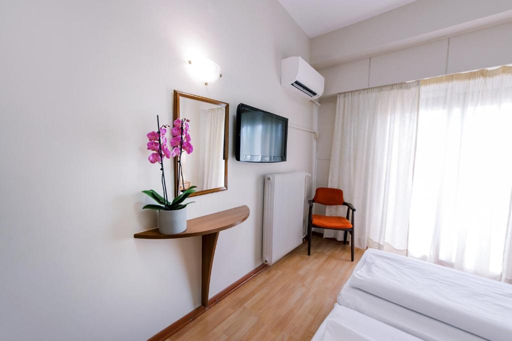 A television and/or entertainment center at Hotel Cronos