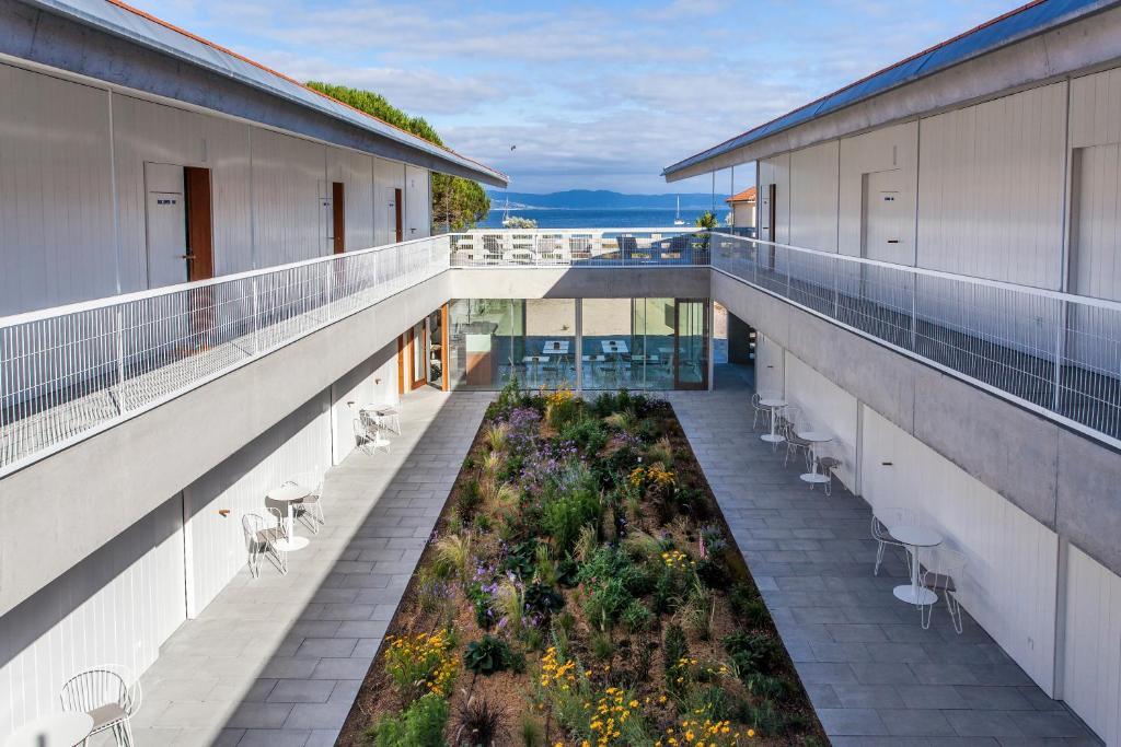 A balcony or terrace at Hotel Bela Fisterra