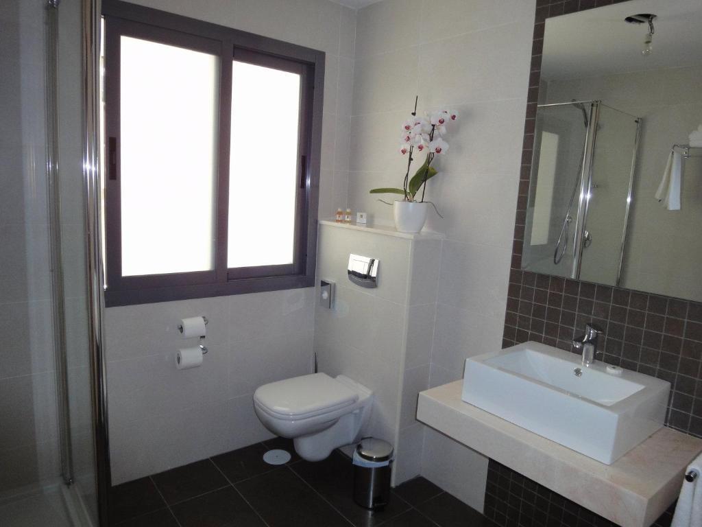 Een badkamer bij Hotel Avenida 31