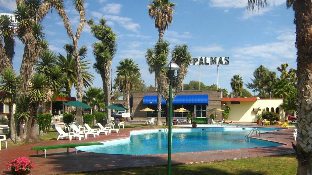 The swimming pool at or near Hotel Las Palmas Midway Inn
