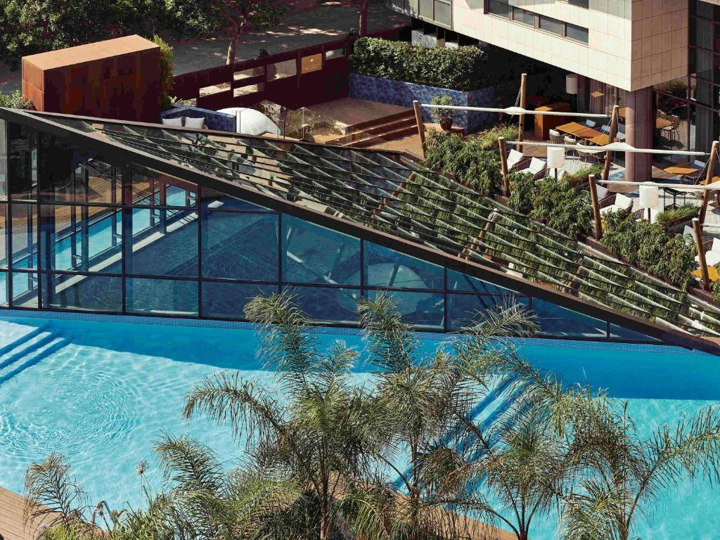 A view of the pool at Pullman Barcelona Skipper or nearby