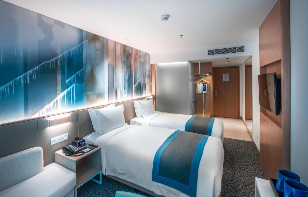 Кровать или кровати в номере Holiday Inn Express Manila Newport City, an IHG Hotel