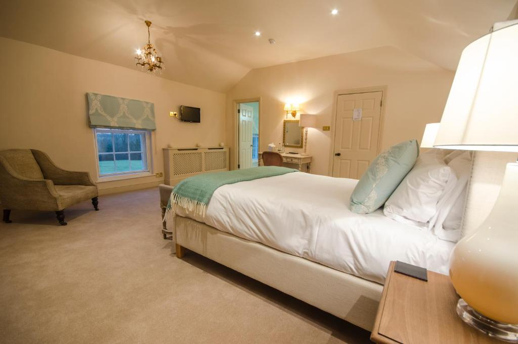A bed or beds in a room at The Black Lion, Long Melford