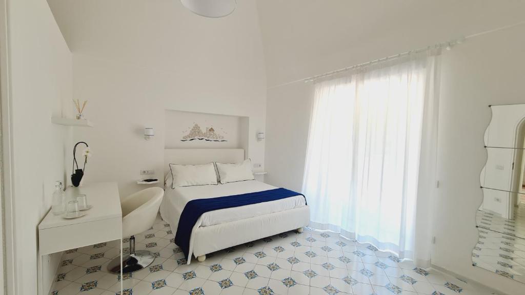 Letto o letti in una camera di Casa Mandara B&B