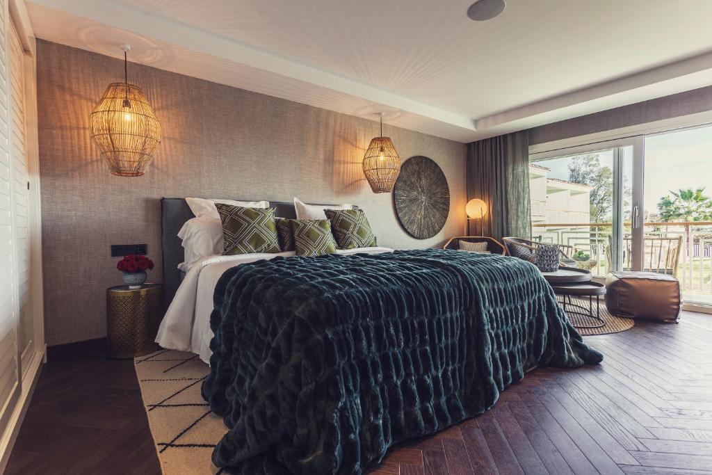 Een bed of bedden in een kamer bij Boho Club