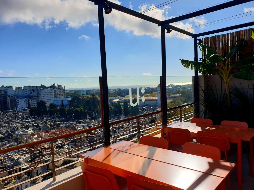A restaurant or other place to eat at Urban Suites Recoleta Boutique Hotel