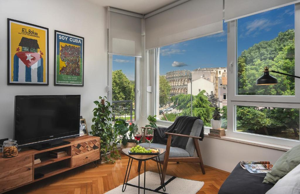 A television and/or entertainment center at Place to be - Center apartment