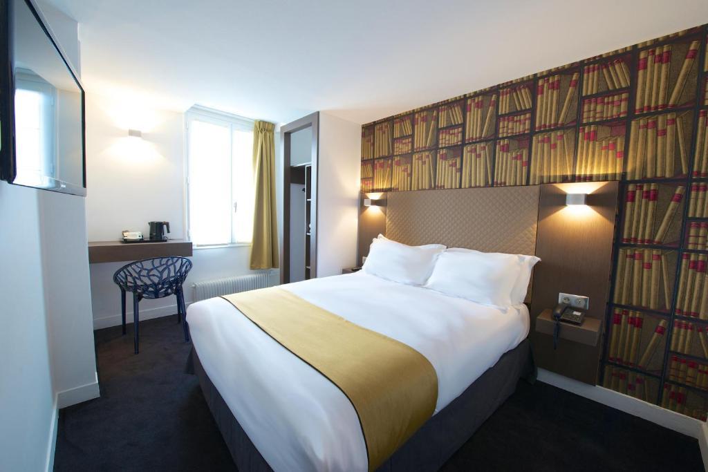 Un ou plusieurs lits dans un hébergement de l'établissement Hôtel de la Gaîté