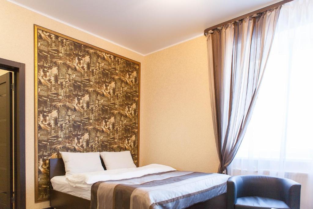 Кровать или кровати в номере Апарт Отель