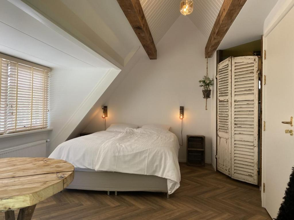 A bed or beds in a room at So Hum