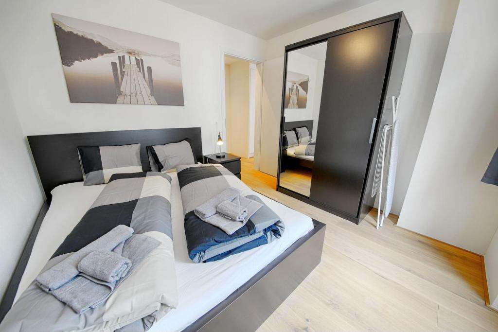 Ein Bett oder Betten in einem Zimmer der Unterkunft HITrental City Apartments