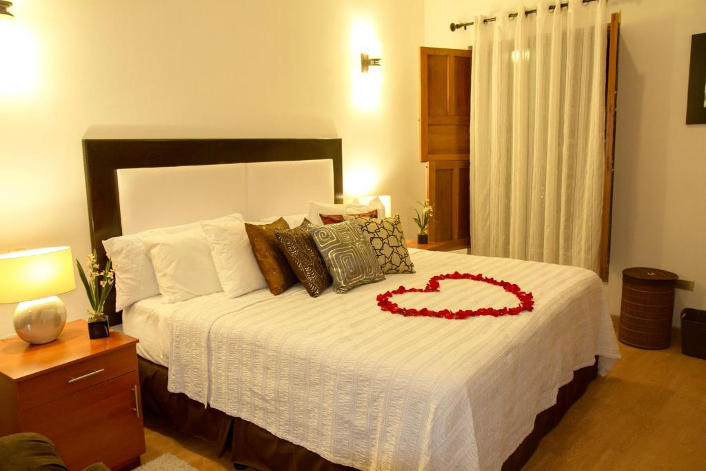 A bed or beds in a room at Flores Hotel Boutique