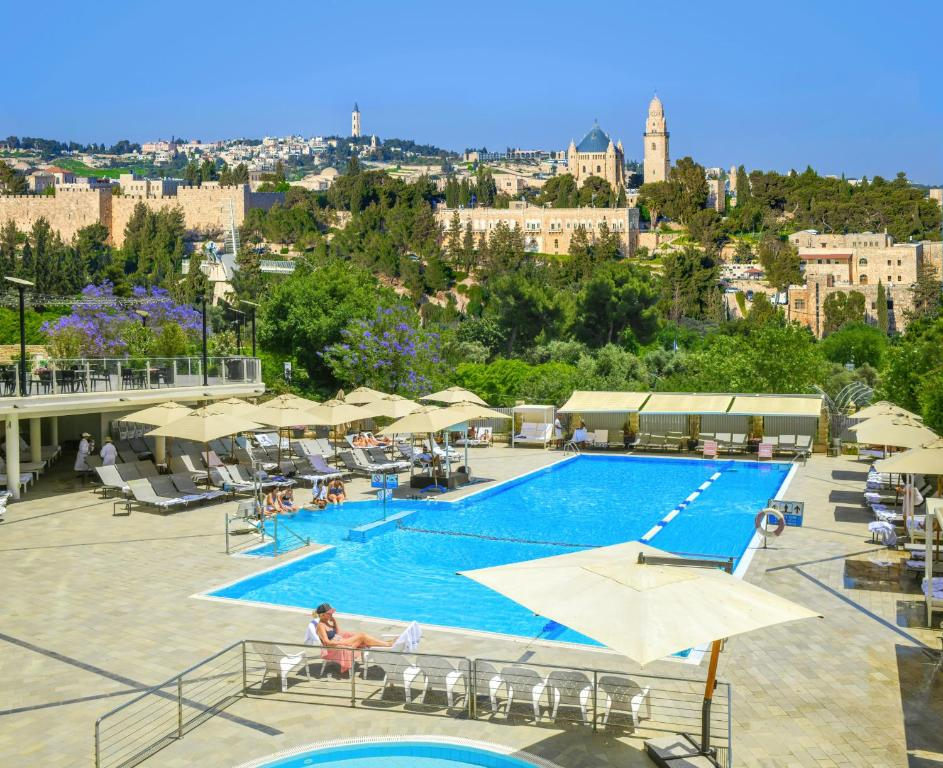 A view of the pool at The Inbal Jerusalem or nearby
