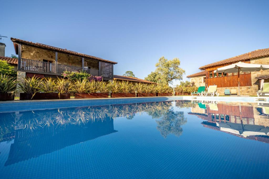 The swimming pool at or near Casa Casal Do Carvalhal