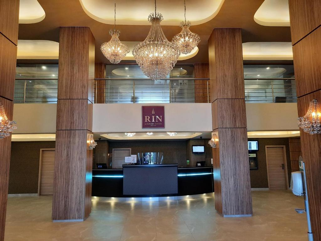 The lobby or reception area at RIN Airport Hotel