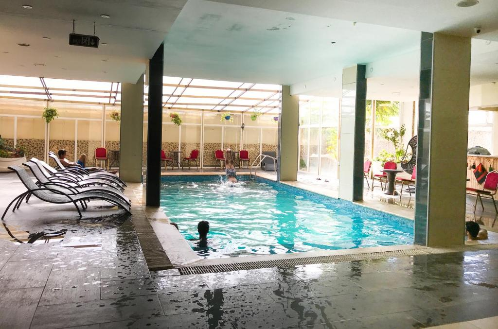 The swimming pool at or close to Tetra Tree Hotel