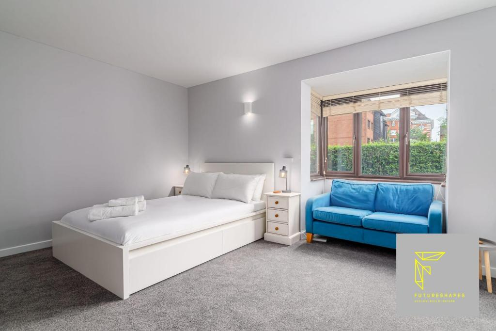 A bed or beds in a room at GuestReady - Cosy Wimbledon Studio Flat