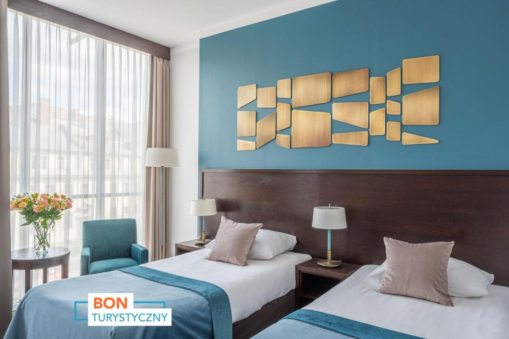 A bed or beds in a room at Europeum Hotel