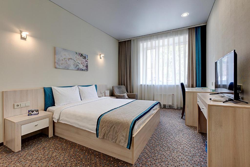 Кровать или кровати в номере Hotel Berg Haus
