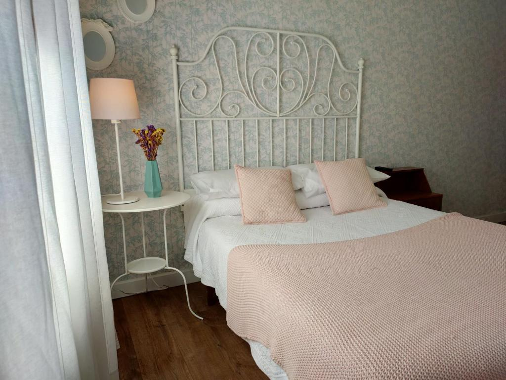 A bed or beds in a room at Casa castro