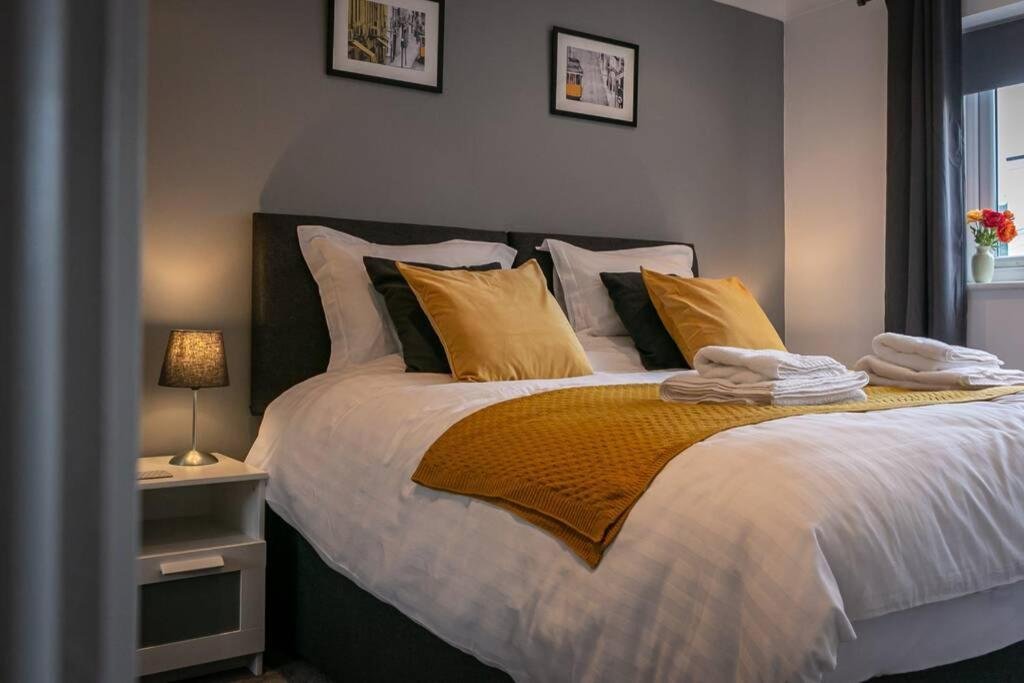 A bed or beds in a room at St Albans City Apartment