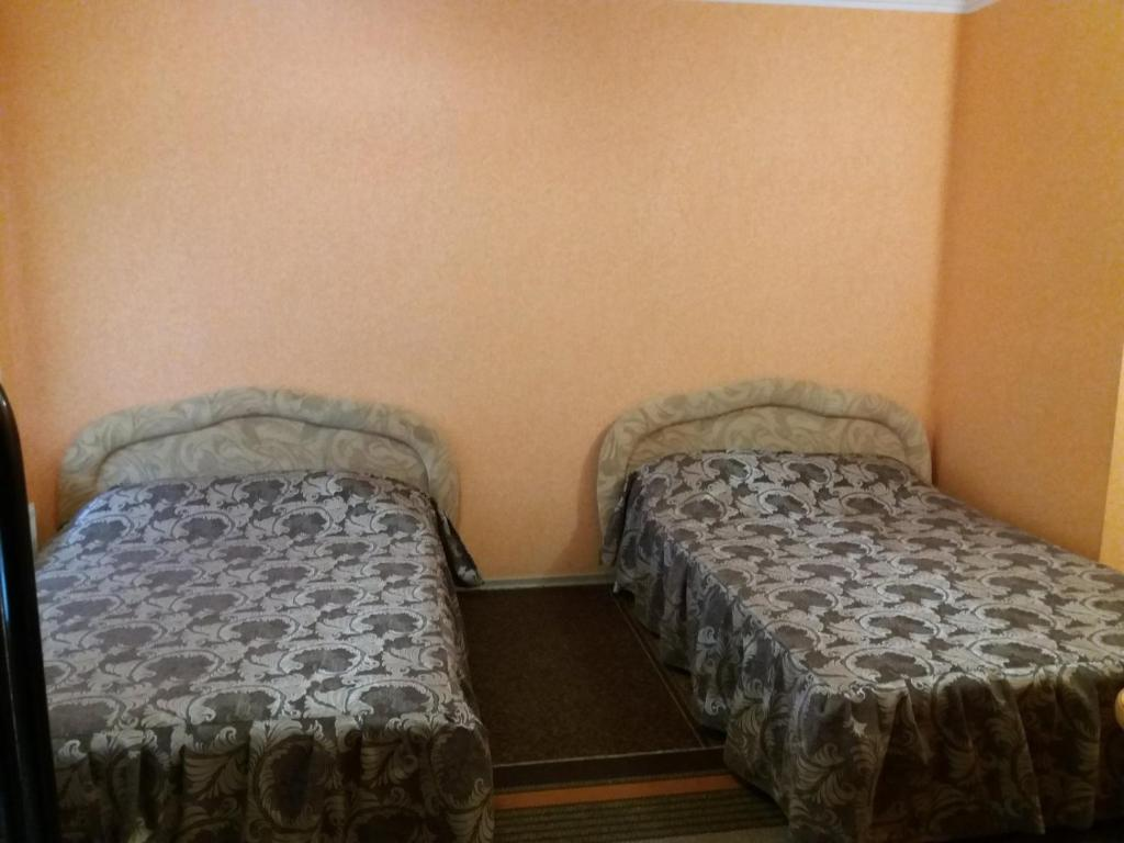A bed or beds in a room at Hotel Kiev-S