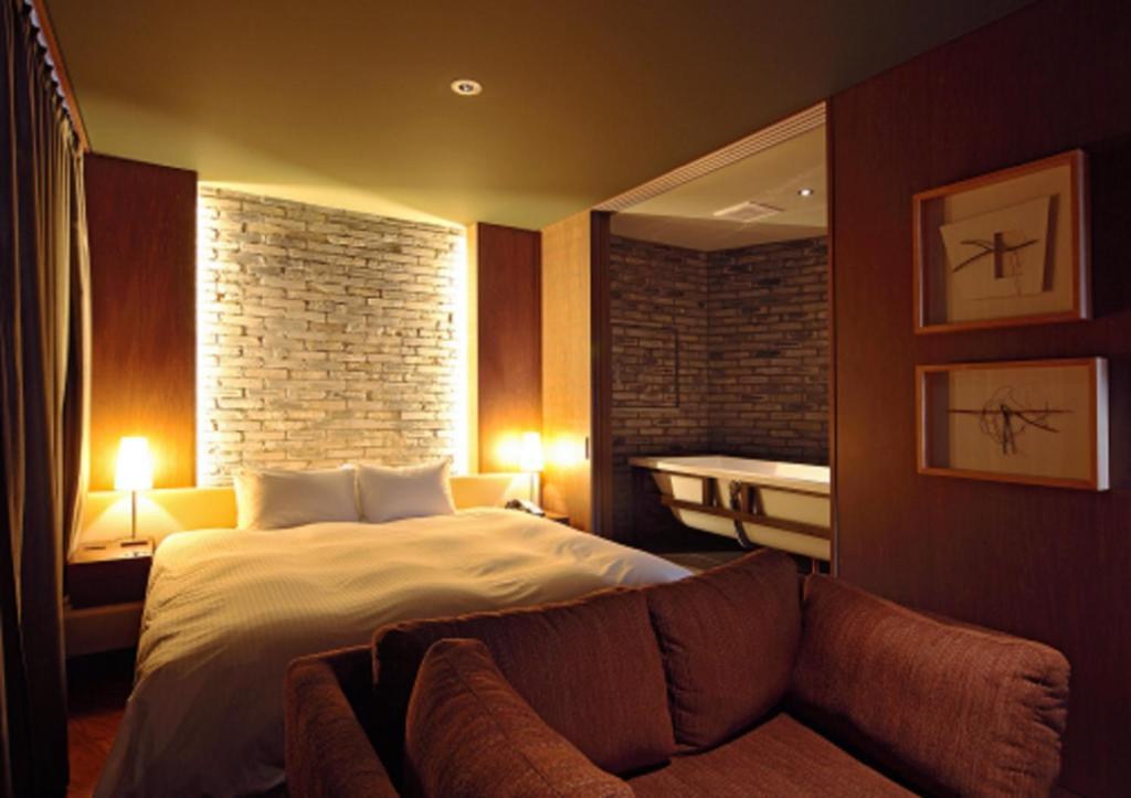 Ein Bett oder Betten in einem Zimmer der Unterkunft Shibuya Granbell Hotel