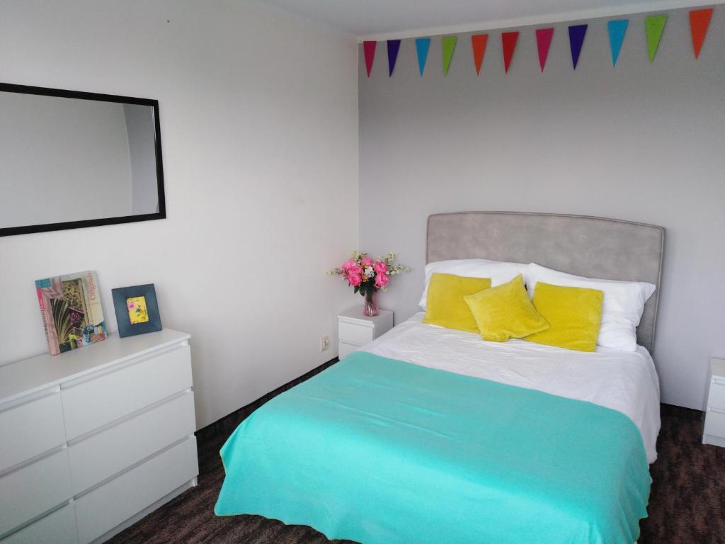 Łóżko lub łóżka w pokoju w obiekcie 7 Niebo