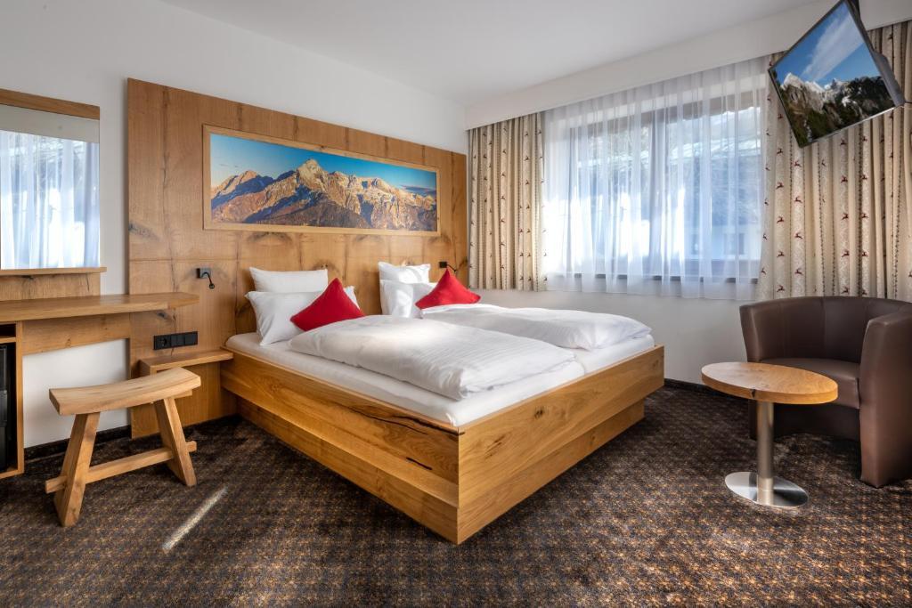 Ein Bett oder Betten in einem Zimmer der Unterkunft Alpenhotel Denninglehen