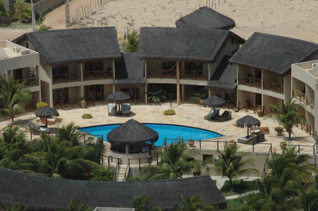 Uma vista da piscina em Pousada Aruana ou nos arredores