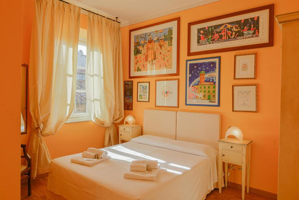 A bed or beds in a room at Albergo San Martino