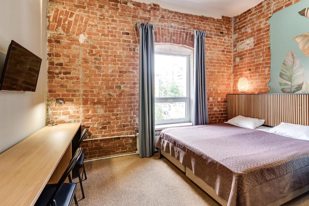 Nabokov Loft-Hotelにあるベッド