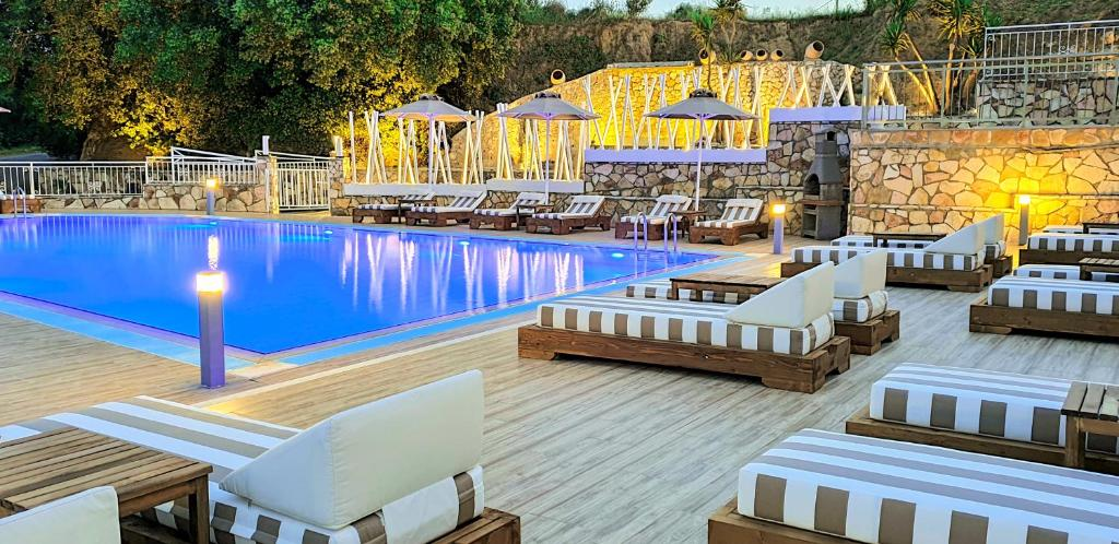 """The swimming pool at or near The """"L"""" Suites & Apartments"""