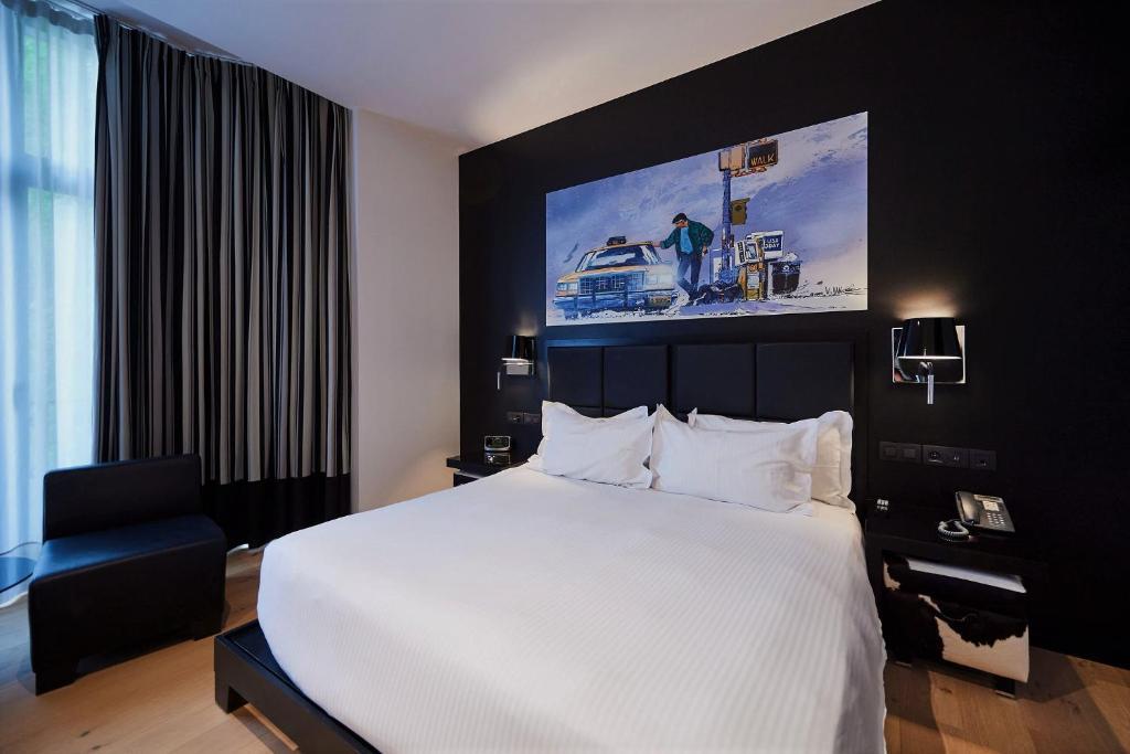 מיטה או מיטות בחדר ב-YOOMA Urban Lodge