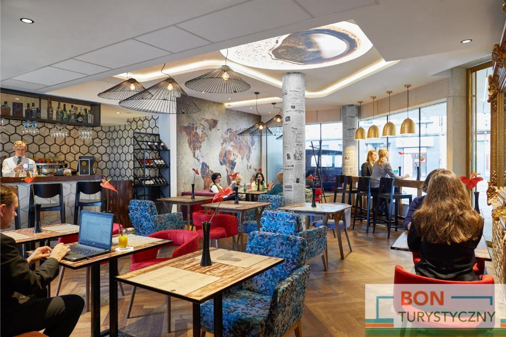 A restaurant or other place to eat at INX Design Hotel