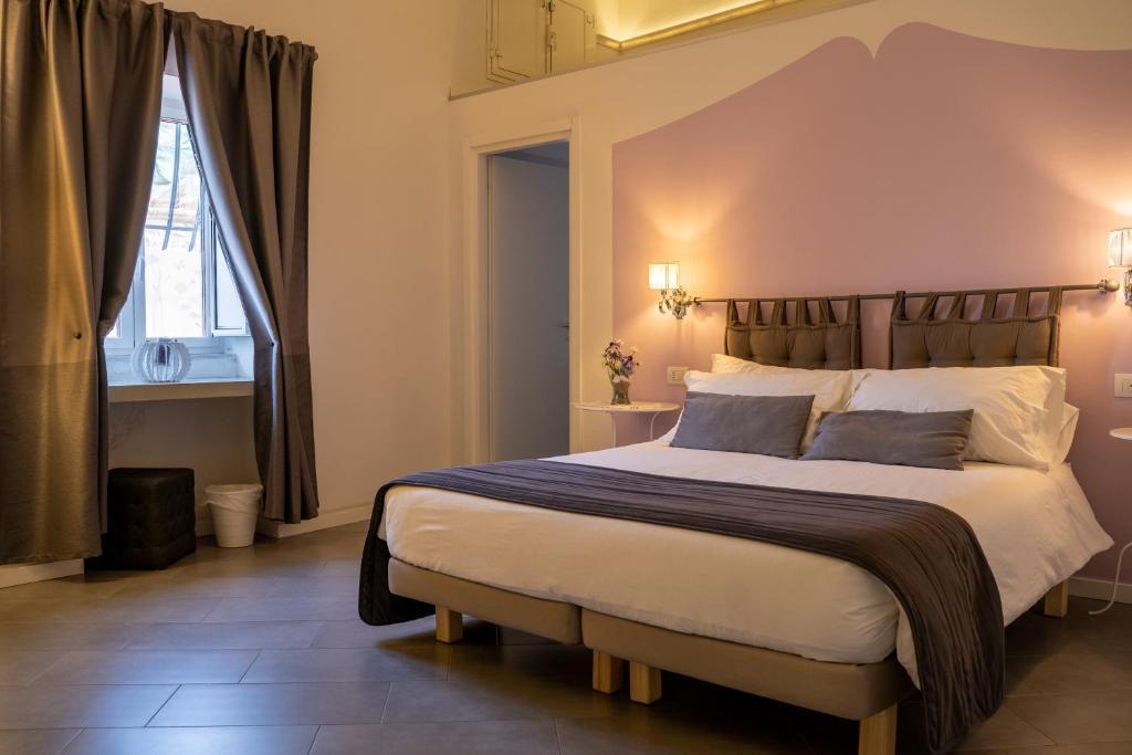 Krevet ili kreveti u jedinici u objektu Sotto le Stelle ai Decumani