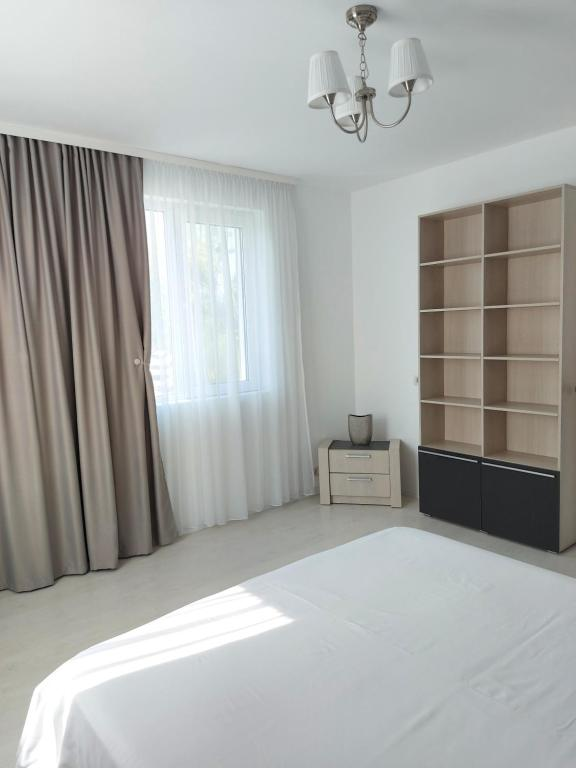 A bed or beds in a room at Villa Romelia