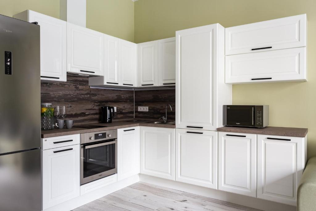A kitchen or kitchenette at Апартаменты с подземным паркингом