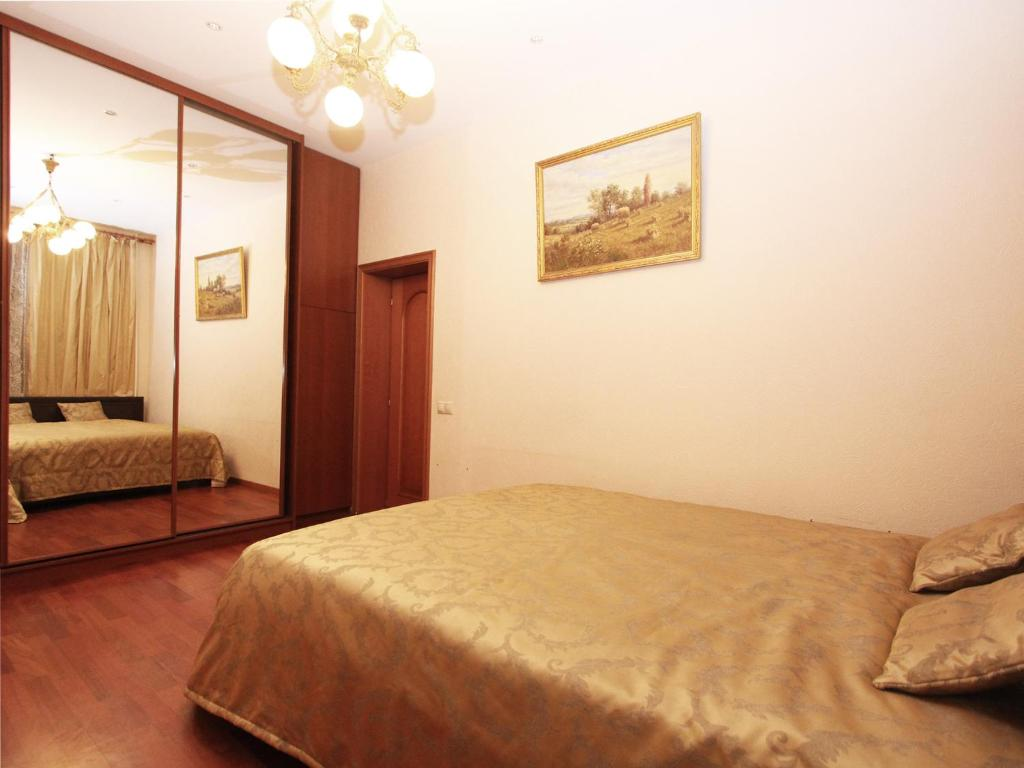 Кровать или кровати в номере ApartLux Университет