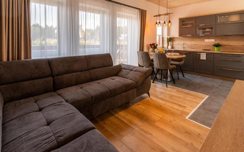 Posedenie v ubytovaní Villa Gloria Rooms & Apartments