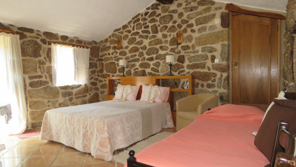 Uma cama ou camas num quarto em Quinta da Ribeira
