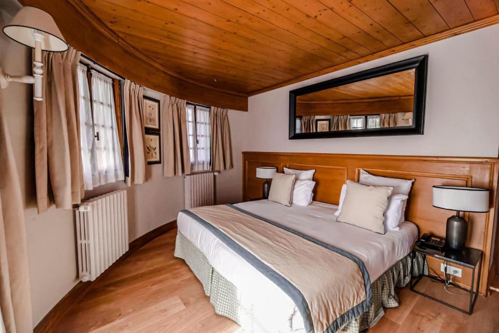 Un ou plusieurs lits dans un hébergement de l'établissement Au Vieux Moulin