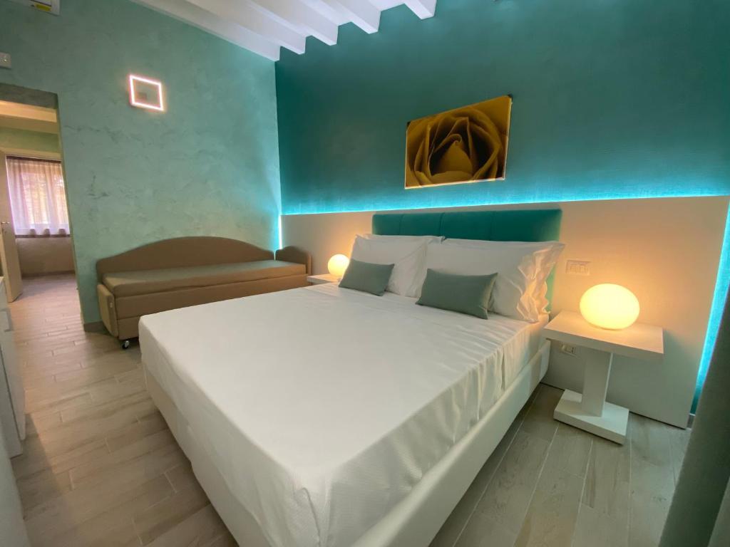 Letto o letti in una camera di B&B affittacamere Al Vulcanetto